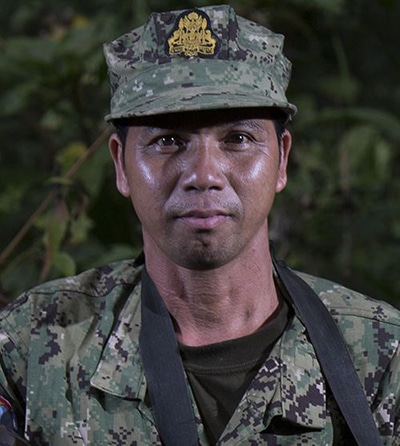 """Cheab Thom, 44, hunted wild pigs, deer, pangolin, and other """"high-value animals"""" around Veun Sai, his hometown, during his twenties. Yet, income from the sale of these species was still not enough to support his seven-member family. As a ranger since 2002, Thom patrols the national park and investigates signs or claims of logging and poaching. He is now able to provide for his family while using his knowledge to help the Conservation International team protect the forest's unique flora and fauna."""